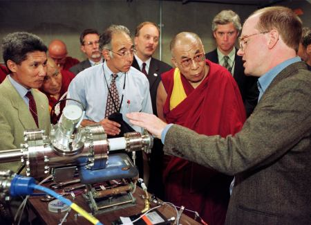 Dalai Lama with industrialists, listening to explaination about a generator